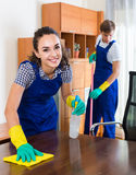 Portrait of people in overalls with supplies doing clean-up Royalty Free Stock Photography