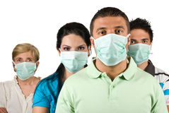 Portrait of people protect from flu. Portrait of few people group standing straight and wearing protective mask trying to protect them from flu epidemiology royalty free stock photos