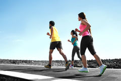 Portrait of people running together Royalty Free Stock Photos