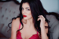 Portrait of perfect, sexy young woman in lingerie with long black hair, healthy skin and red lips. Beauty nude make up Royalty Free Stock Image