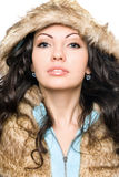Portrait of perfect young brunette in the hood Royalty Free Stock Images