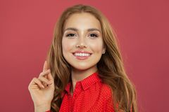 Portrait of perfect young woman on coral pink background. Beautiful pretty girl smiling and having fun. Positive emotions,. Attractive female face royalty free stock photography