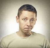 Portrait of perplexed man Stock Photos
