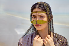 Portrait of Persian girl in traditional Muslim mask southern Ira. Close-up portrait of an Iranian girl in traditional Islamic dress of southern Iran Stock Photography