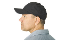 Portrait of the person in a cap. On a white background Royalty Free Stock Image