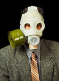Portrait of person in gas mask on black Stock Photos