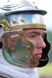 Portrait of person in historical costume wearing helmet Stock Images