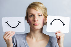 Portrait of a Person Holding Happy and Unhappy Mood Board Stock Image