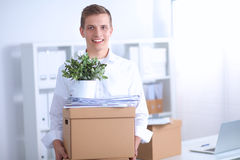 Portrait of a person with moving box and other Royalty Free Stock Image