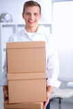 Portrait of a person with moving box and other Royalty Free Stock Photos