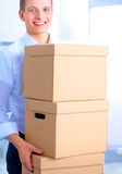 Portrait of a person with moving box and other stuff isolated on white Royalty Free Stock Photos