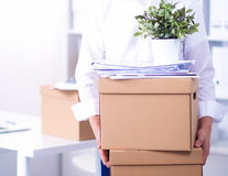 Portrait of a person with moving box and other stuff isolated on white Royalty Free Stock Image