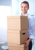 Portrait of a person with moving box and other stuff  on white Royalty Free Stock Image