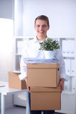 Portrait of a person with moving box and other stuff  on white Stock Photography