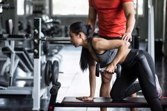 trainer coach dumbbell exercise to woman