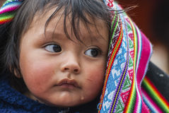 Portrait of Peruvian child. Peruvian child in Calca, Perù during a religious celebration Stock Photo