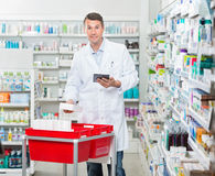 Portrait Of Pharmacist Counting Stock While Stock Image