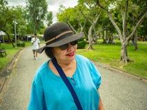 Portrait Photo of Asian Senior women walking in Chatuchak park Bangkok city. Portrait Photo of Asian Senior woman walking in Chatuchak park Bangkok city Thailand royalty free stock image
