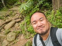 Portrait photo of Asian Tourist trekking to the top of Khao Luang mountain in Ramkhamhaeng National Park. Sukhothai province Thailand stock images