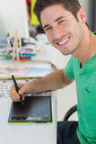 Portrait of a photo editor working on graphics tablet Royalty Free Stock Images