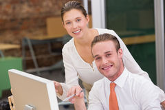Portrait of photo editors using computer in office Royalty Free Stock Image