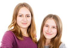 Happy young sisters. Portrait photo of happy young sisters on isolated white background Stock Image