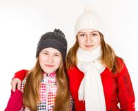 Happy young sisters. Portrait photo of happy young sisters on isolated white background Royalty Free Stock Photo