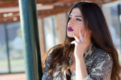 Portrait photo of a lady with bold purple big fleshy lips wear army jacket Stock Photo