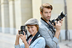 Portrait of photo reporters in town shooting Royalty Free Stock Photography