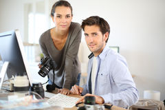 Portrait of photo reporters working at office Royalty Free Stock Photos