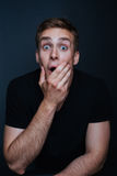 Portrait photo of young man with a surprised expression in v nec. Portrait photo of young men with a surprised expression in v neck t shirt Royalty Free Stock Photo