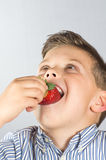 Child eating strawberries 4 Royalty Free Stock Photo