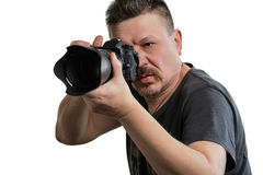 Portrait photographer with a camera on an isolated background. Portrait photographer while working on an isolated white background Stock Images