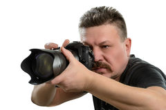 Portrait photographer with a camera on an isolated background Stock Photo