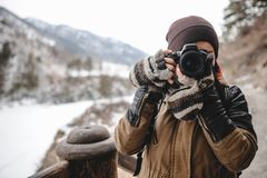 Portrait of photographer taking pictures with digital camera outdoor. Close up portrait of photographer taking pictures with digital camera. Outdoor in winter stock photography