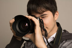 Portrait of photographer using professional camera Royalty Free Stock Photos