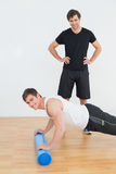 Portrait of physical therapist with young man doing push ups Royalty Free Stock Photos