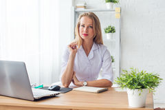 Portrait of physician working in her office sitting workplace. Royalty Free Stock Image