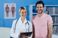 Portrait of physiotherapist and male patient Royalty Free Stock Photos