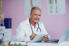 Portrait of physiotherapist using digital tablet. In clinic Royalty Free Stock Images