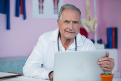 Portrait of physiotherapist using laptop Royalty Free Stock Images