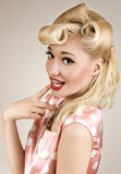 Portrait of pin-up blonde woman. With finger on her lips Stock Images