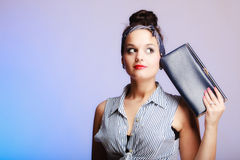Portrait pin-up girl with black handbag on violet. Party or date. Royalty Free Stock Images