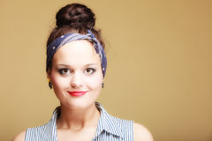 Portrait pin-up girl with bun and hairband on brown. Fashion. Stock Photo