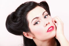Portrait of pin-up girl with make-up and hairstyle Royalty Free Stock Photography