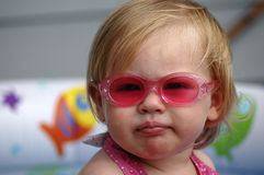 Portrait with Pink Sunglasses. A portrait of an adorable baby girl wearing pink sunglasses royalty free stock photo