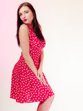 Portrait pinup girl brunette woman in retro red dress. Vintage. Royalty Free Stock Photography