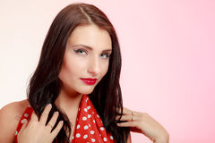 Portrait pinup girl brunette woman in retro red dress. Vintage. Stock Photo