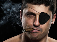 Portrait of a pirate with a cigar Royalty Free Stock Images