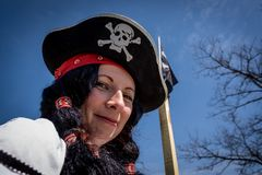 Portrait of a pirate woman wearing hat and costume. Carnival party stock photos